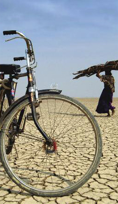 Drought Conditions, bycicle and woman walking