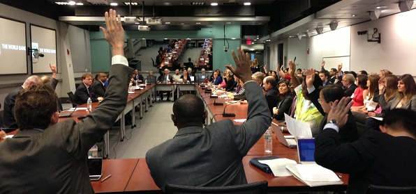 Participants who work for Independent Accountability Mechanisms raise their hands at a recent event at the World Bank